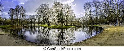 Pond panoramic landscape photo in Vondelpark, Amsterdam.