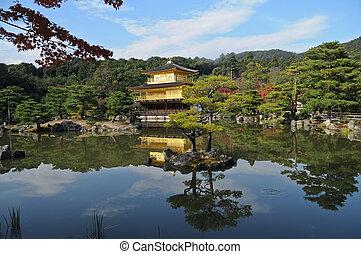 Pond reflection and Japanese golden pavillion Kinkakuji in...