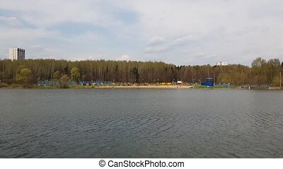 pond with beach in Moscow, Russia - pond with a beach in...