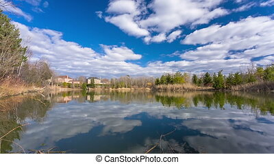 Pond with private homes. 14bit raw high quality video