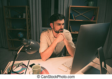 Ponder strict man thinking about way to complete his job