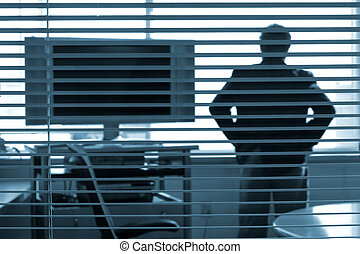 pondering the presentation - Silhouette of a man with his...