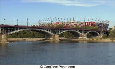 Poniatowski Bridge and Polish National Stadium across the Vistula River in Warsaw, Poland.