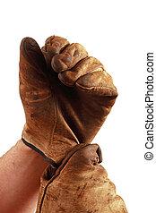 poniendo, guantes del trabajo