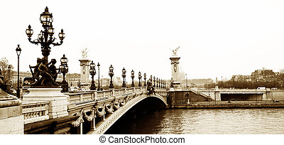 Pont Alexandre III - Bridge in Paris, France. Movement on cars driving � Gloomy winters day. Copy space, sepia tone