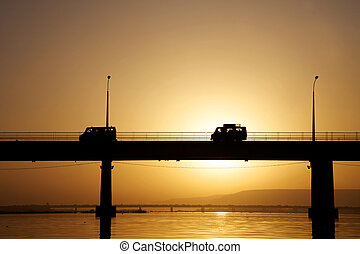 Pont des martyrs Bridge in Bamako - on the river the Niger with a beautiful sunset with people, cars.