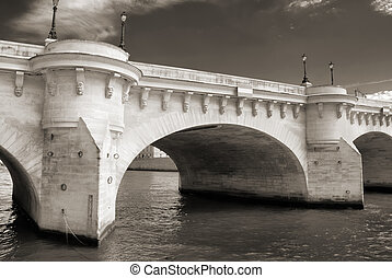 The Pont Neuf, the oldest standing bridge across the river Seine in Paris, France.