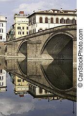 Ponte alla carraia bridge reflected on river Arno