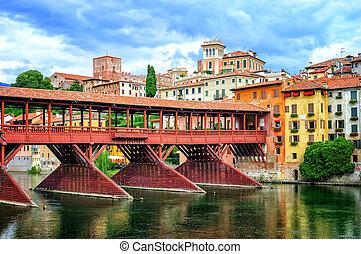 Famous wooden bridge Ponte degli Alpini over river Brenta in Bassano del Grappa, a little town in Veneto, Italy