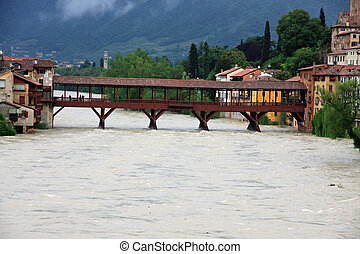ponte degli alpini in bassano during a strong wave of bad weather with the brown river brenta