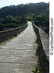 """Ponte della Maddalena, aldo wnown as """"Ponte del DIavolo (Evil's Bridge), near Borgo a Mozzano (Lucca, Tuscany, Italy), over the Serchio river, at summer"""