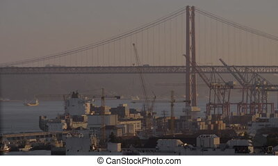 Ponte Vasco da Gama and a cargo ship dock - A view of Vasco...