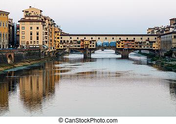 Ponte Vecchio Bridge Across Arno River in Florence at...
