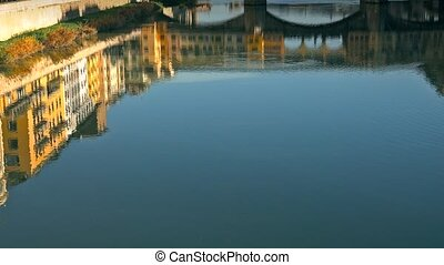 Ponte Vecchio bridge and Florentine houses reflection on...