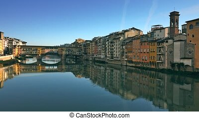 Ponte Vecchio bridge and riverfront buildings in Florence,...
