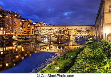Ponte Vecchio bridge in Florence, Italy. Arno River at night