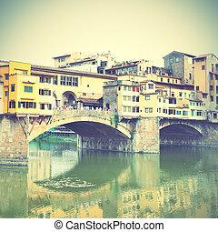 Ponte Vecchio bridge in Florence, Italy. Sepia toned.