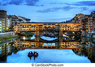 Ponte Vecchio bridge in Florence, Italy. Arno River at night