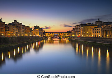 Ponte Vecchio landmark on sunset, old bridge, Arno river in Florence. Tuscany, Italy.