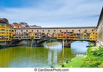 Ponte Vecchio, medieval stone arch bridge over the Arno...