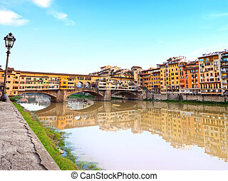 Ponte Vecchio, old bridge, medieval landmark on Arno river and its reflection. Florence, Tuscany, Italy.