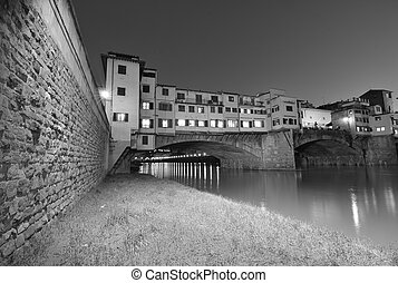 Ponte Vecchio over Arno River, Florence, Italy. Beautiful black and white view.