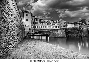 Ponte Vecchio over Arno River, Florence, Italy. Beautiful black