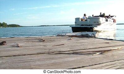 Pontoon Boat Leaving Dock - Group of people having a good...