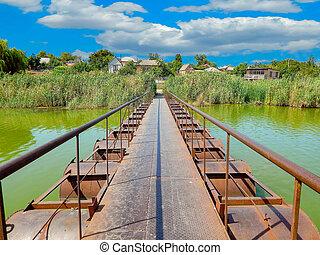pontoon bridge over the river with blue sky