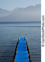 Pontoon with blue carpet and Lake Annecy