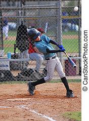 Pony League Baseball - nine year old batter hitting the ball...