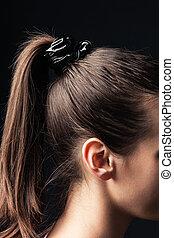 ponytail - closeup of a girl with ponytail studio shot