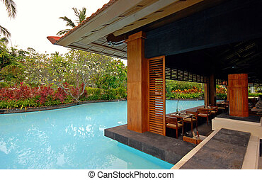 pool and asian pavilion on tropical resort (Bali, Indonesia)...