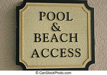 Pool and Beach Access sign at resort
