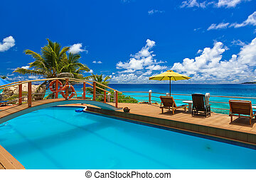 Pool at tropical beach - Seychelles - vacation background