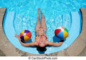 Pool Babe - Woman sunbathing in still blue pool with beach ...