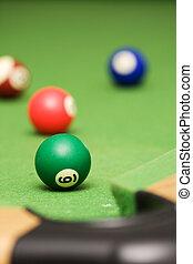 Pool balls on a green pool table - Four pool balls on a...
