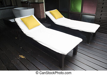 pool bed in The resort is decorated with wood.