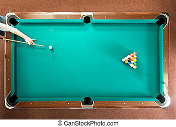 Pool break - Pool player ready for the break, seen from...