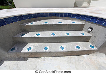 The steps of a swimming pool under construction.