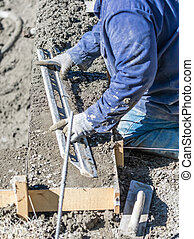 Pool Construction Worker Working With A Smoother Rod On Wet Concrete