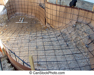 Shot of a pool in construction, ready for the first layer of concrete.