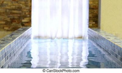 Pool entrance, tile down stairs, water passage to street an...