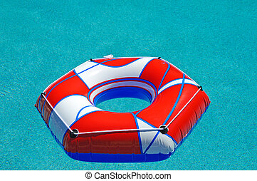 Pool Float - A flotation ring in a swimming pool