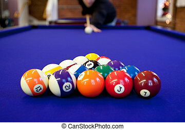 Pool Hall Billiards - Man gets ready to begin breaking the...