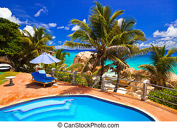 Pool in hotel at tropical beach, Seychelles - vacation ...