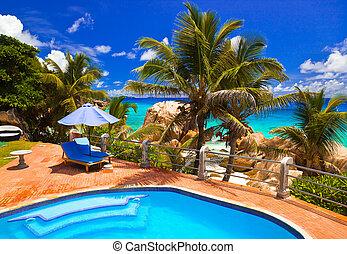 Pool in hotel at tropical beach, Seychelles