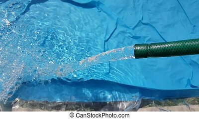 pool., jour, été, remplissage, tuyau, fluxs, ensoleillé, eau, gonflable, dehors