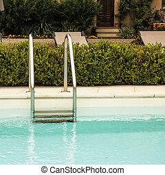 Pool ladder in a garden