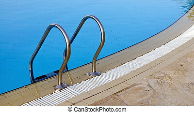 Swimming pool with entry ladder